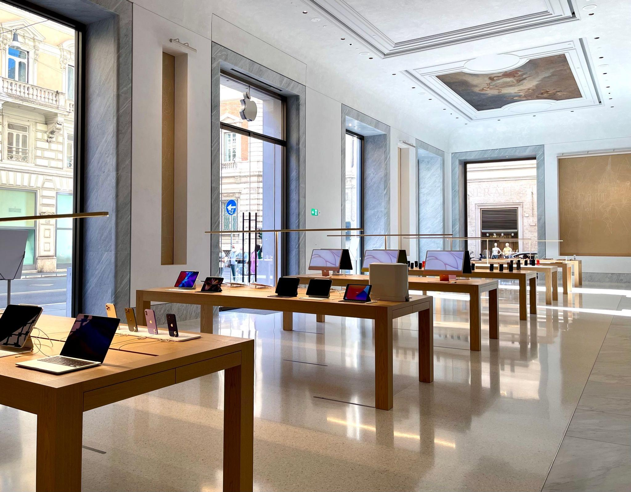 Apple devices, restored ceiling paintings, and the large entrance facing Via del Corso.