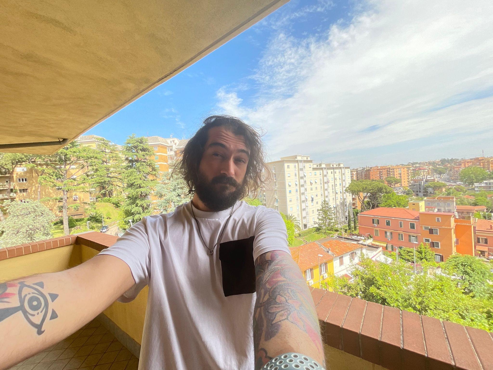 An ultra-wide selfie taken on iPad Pro.